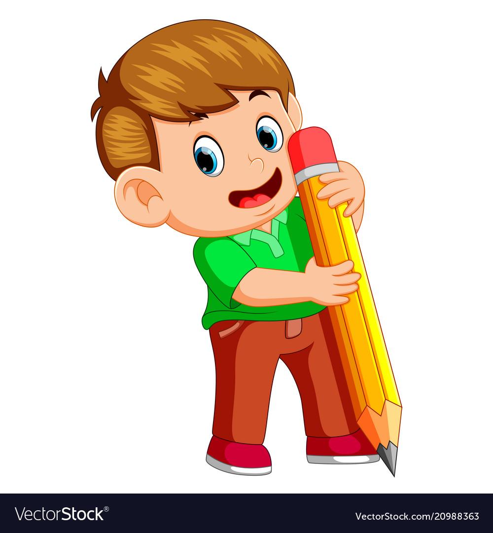 A young boy holding big pencil