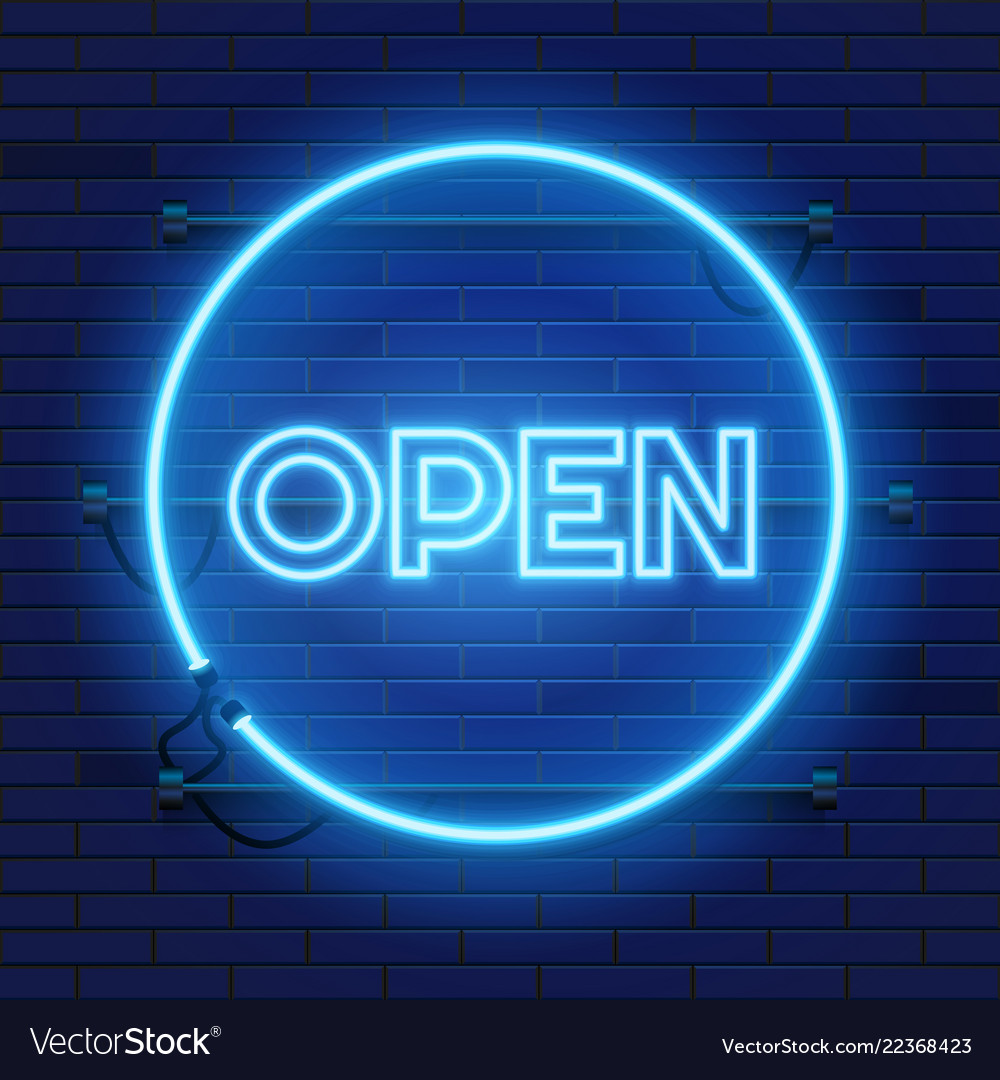 Neon open sign in circle shape on a brick wall