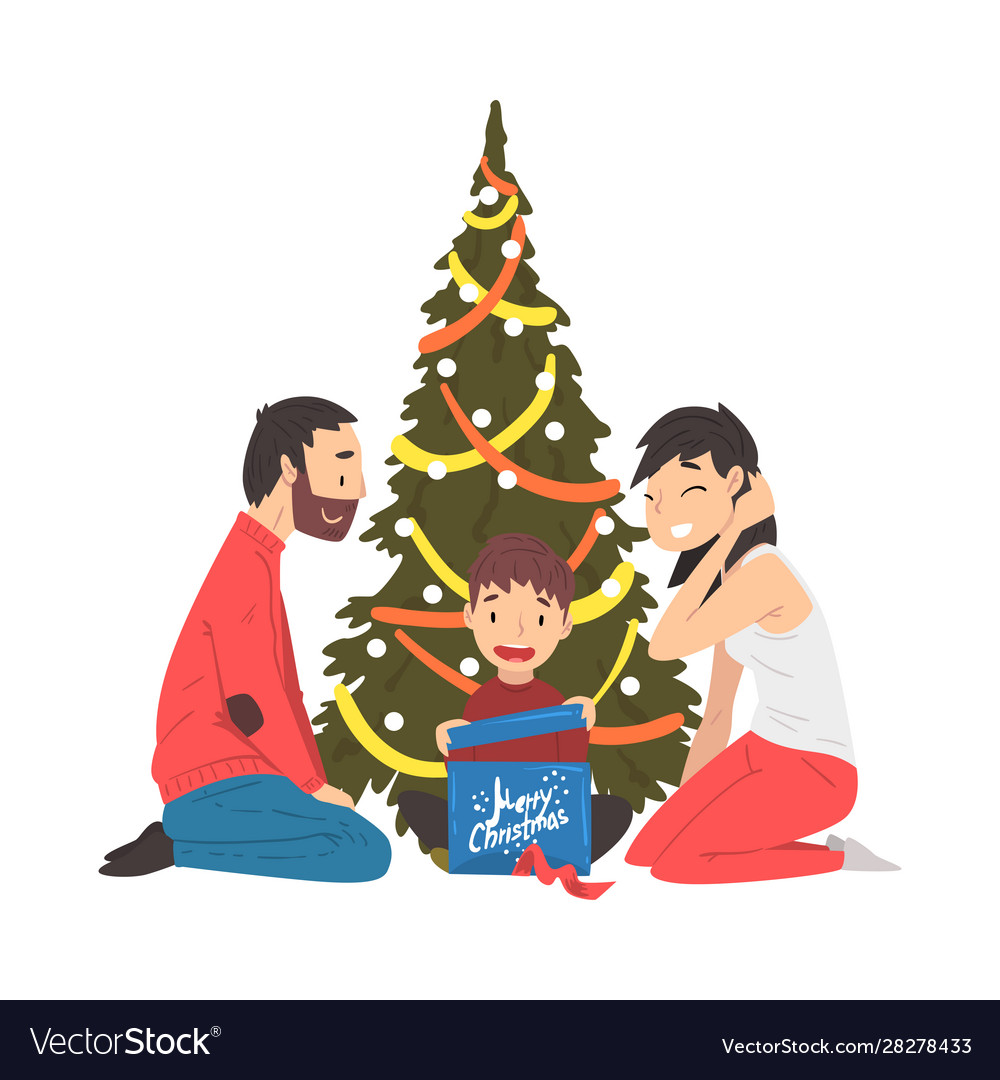 Happy family sitting next to christmas tree cute