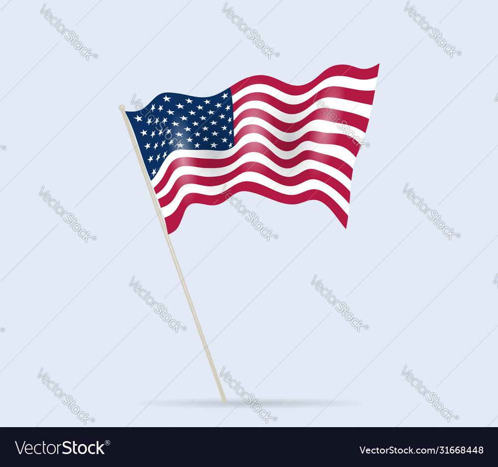 Usa flag on flagpole waving in wind