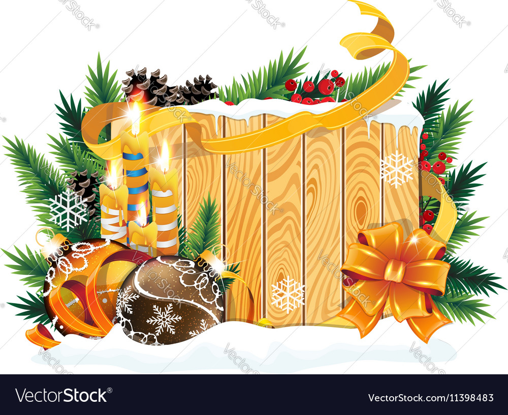 Baubles and burning candles on wooden background