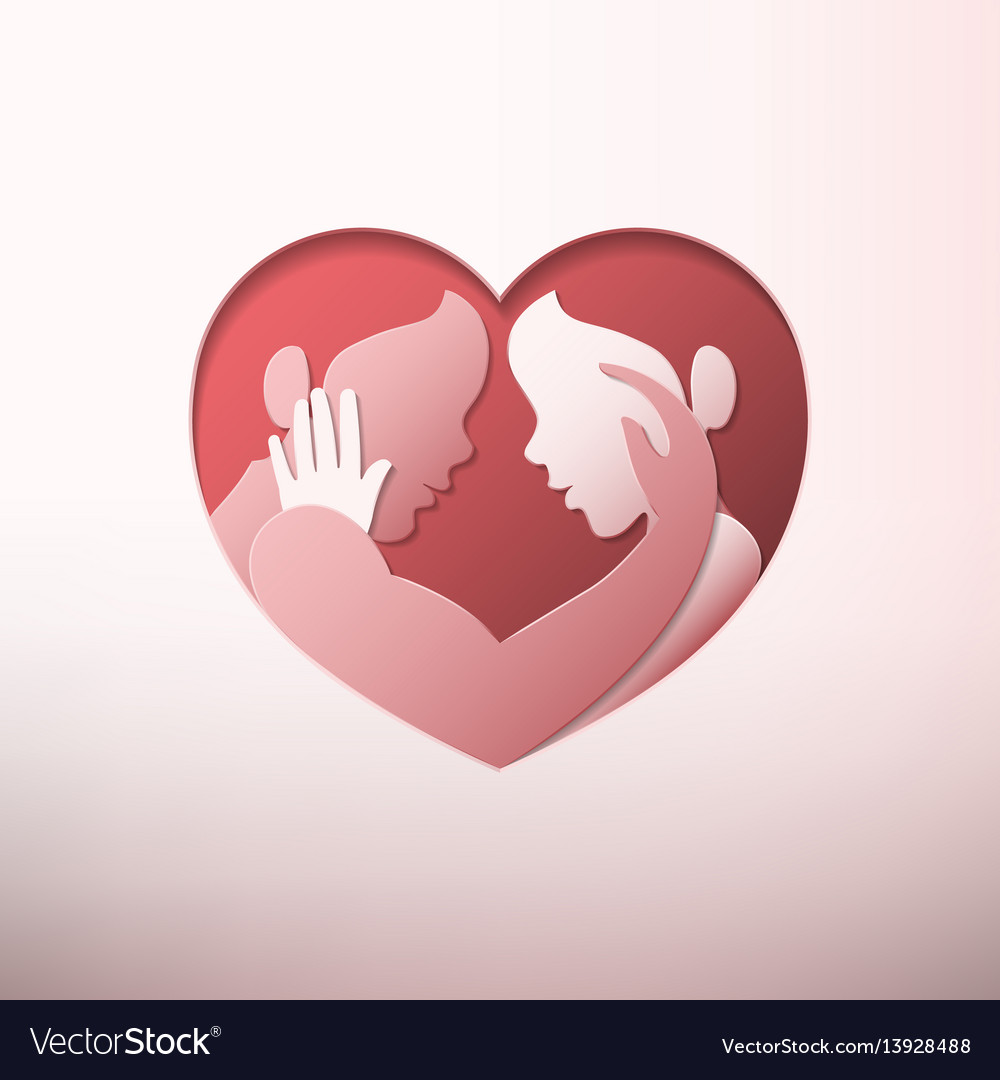 Couple caressing in heart shaped frame paper art