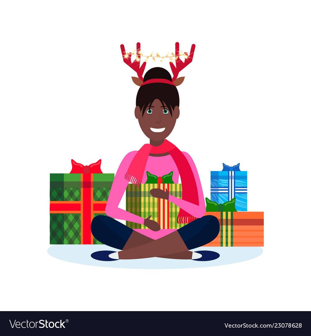 African american woman deer horns sitting lotus