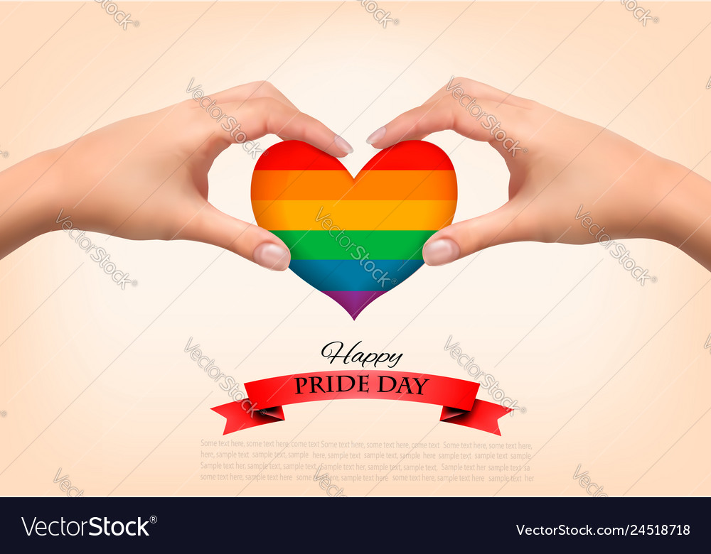 Rainbow heart shaped in hands gay pride concept