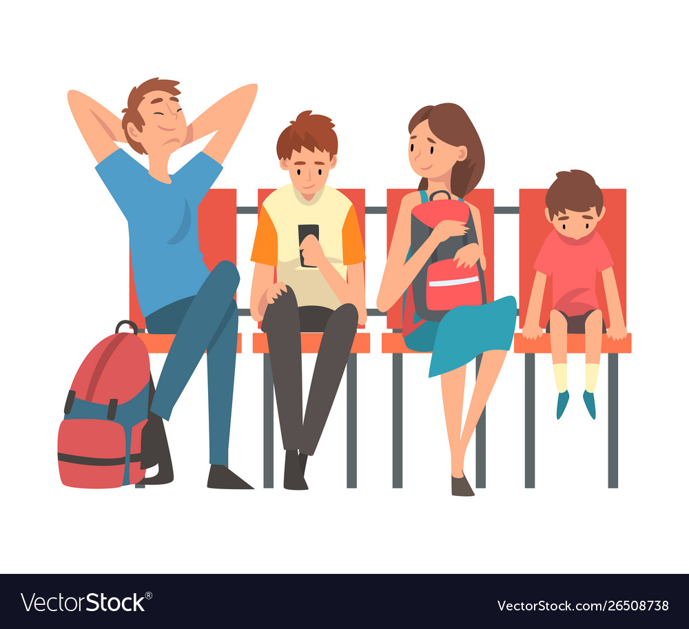 Family waiting at airport terminal for flight