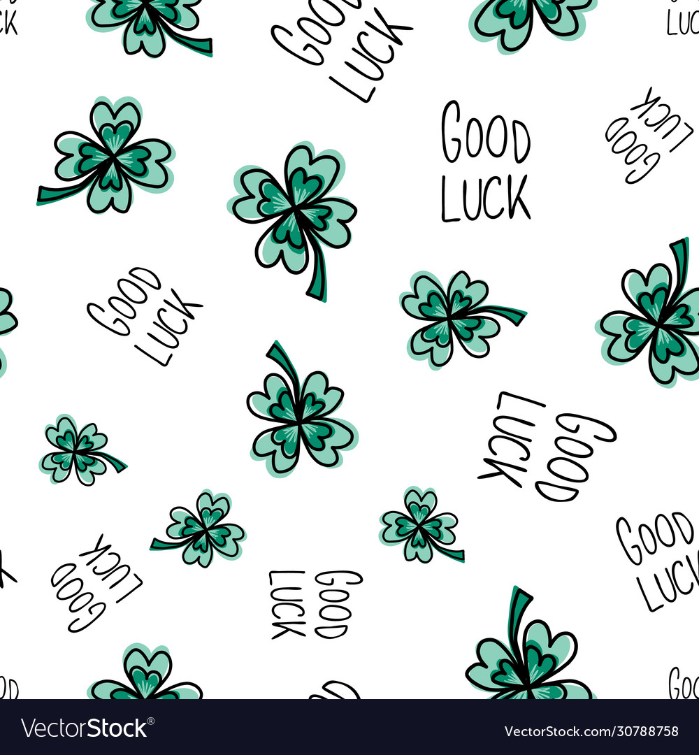 Good luck hand drawn lettering and clover leaves