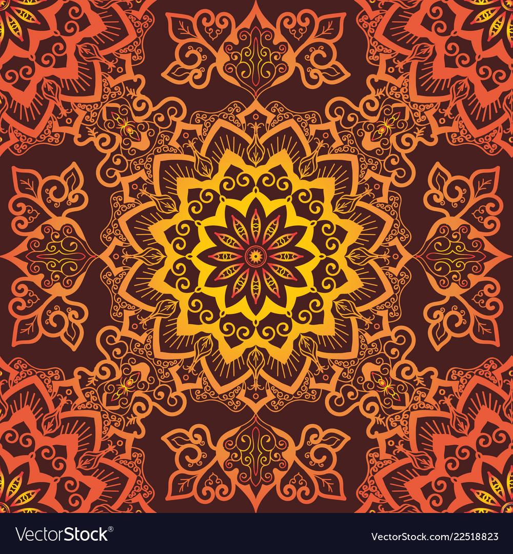 Bright orange mandala pattern ornament on red