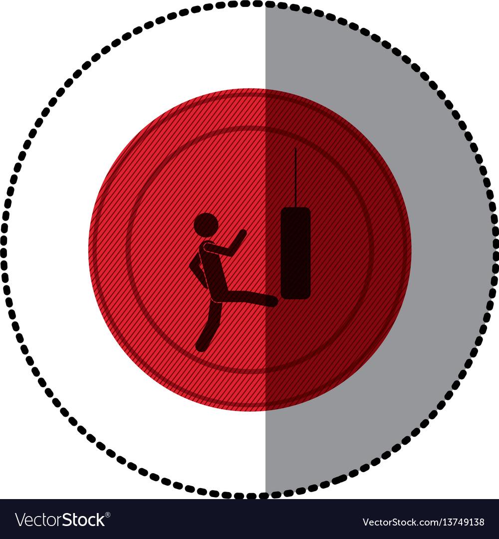 Red symbol person kicking a punching bag