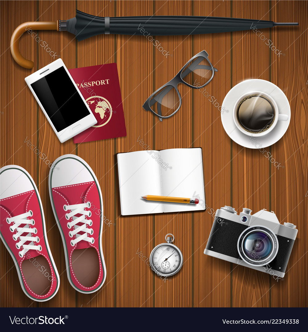 Objects for travel on a wooden background