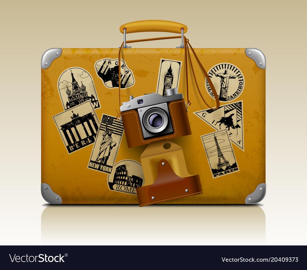 Old small threadbare suitcase with a retro photo