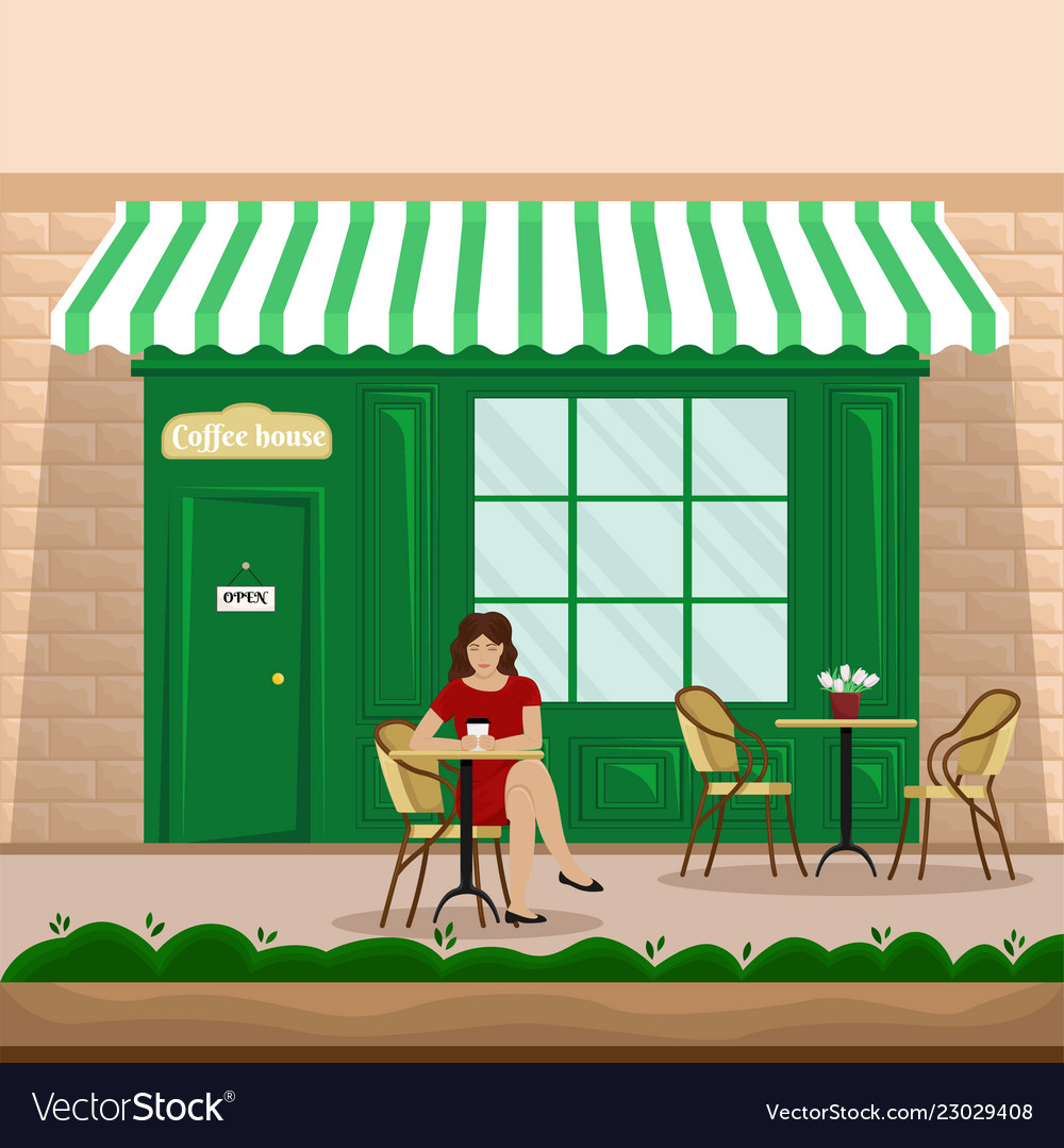 A girl with a cup of coffee at a table in a cafe