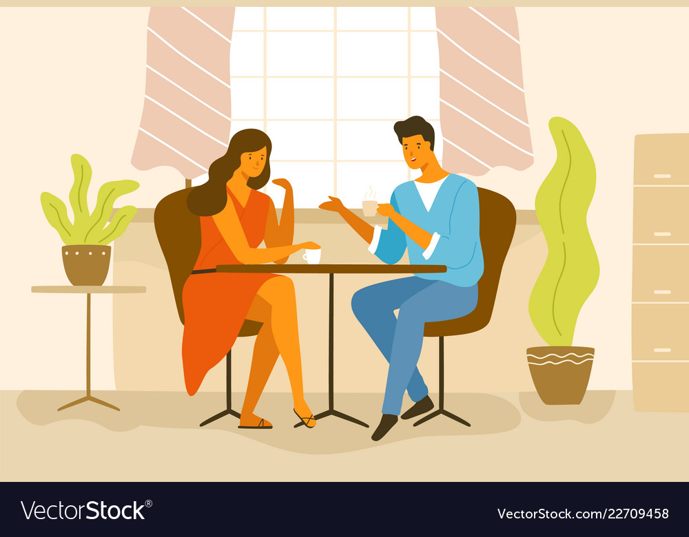 Cute romantic couple sitting at cafe table