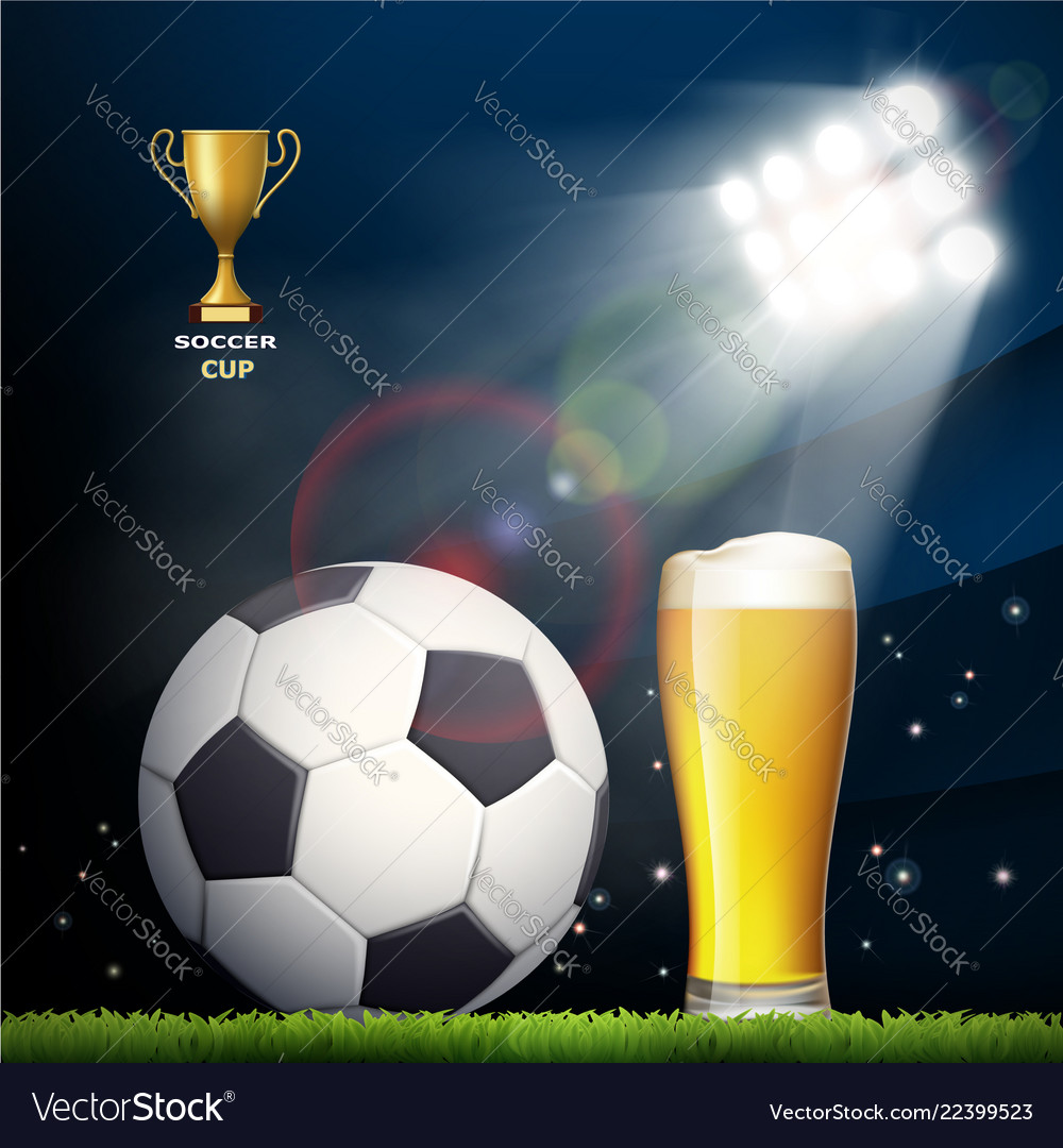 Soccer ball and a glass of beer in the stadium
