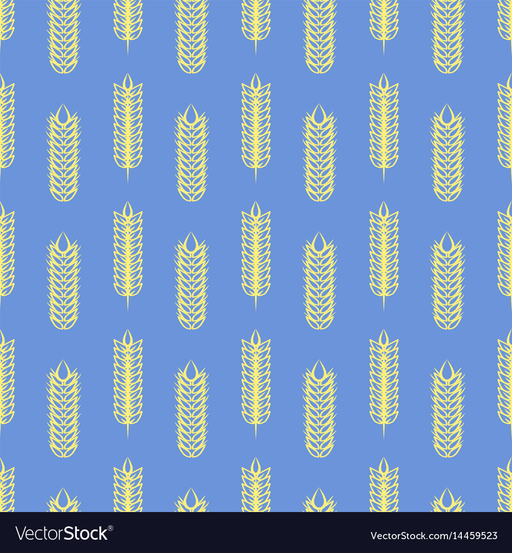 Yellow wheat on blue seamless pattern