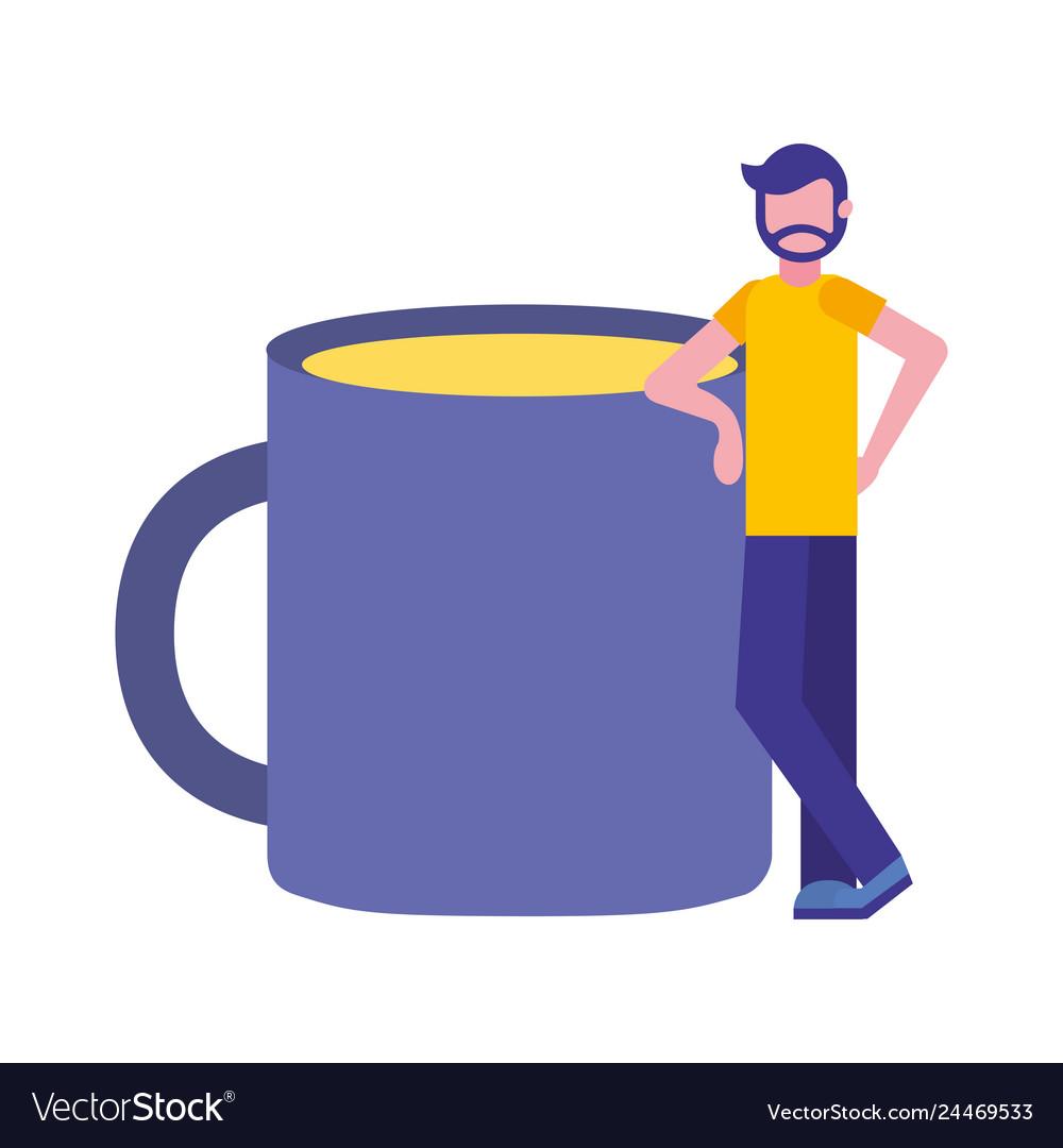 Bearded man standing near coffee cup