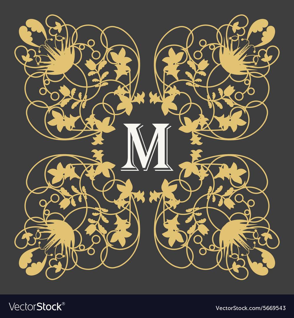 Gold monogram frame with letter m on dark