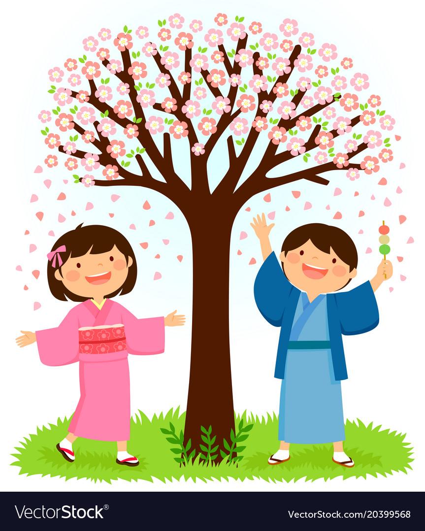 Kids in kimonos standing under a sakura tree