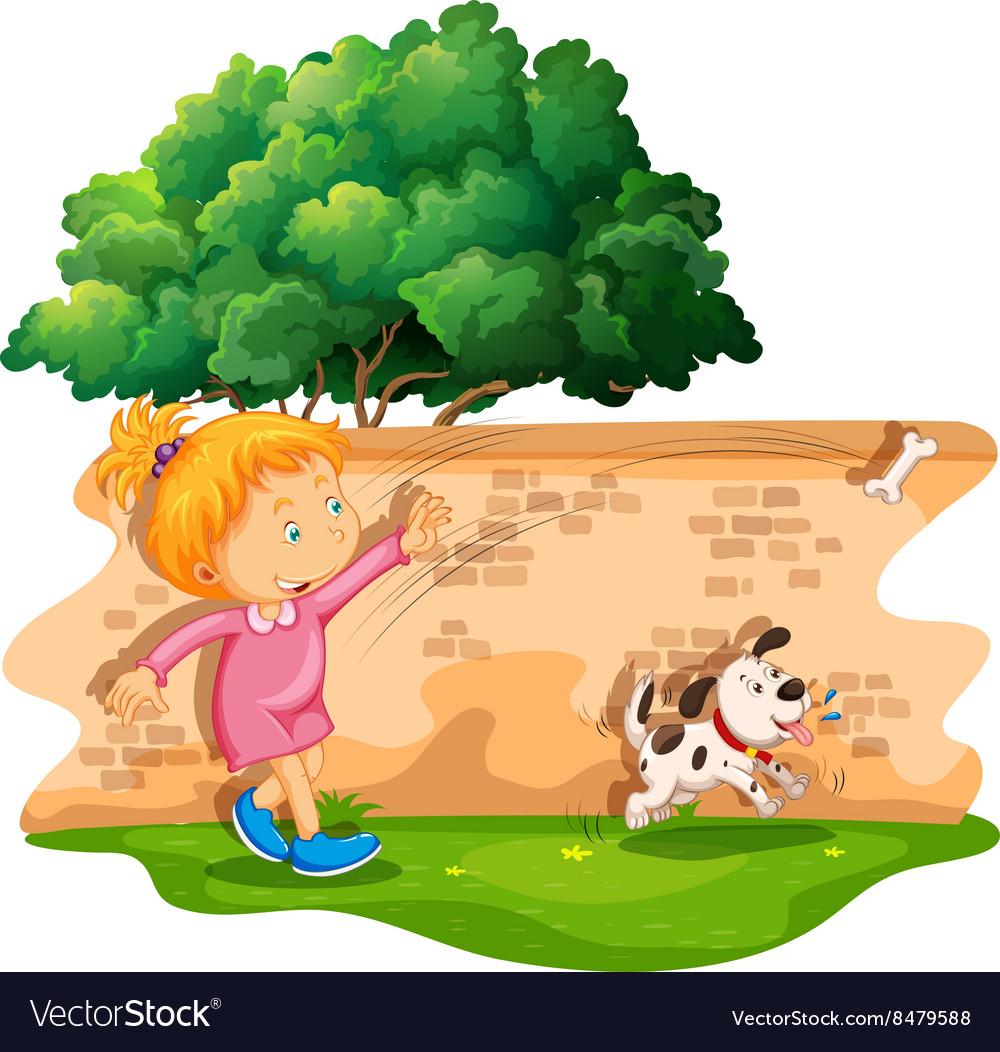 Girl throwing bone for dog