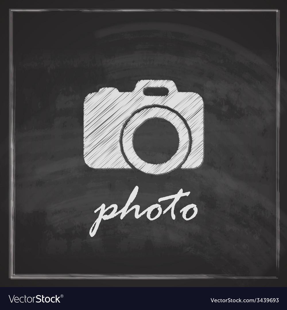 Vintage with camera sign on blackboard background