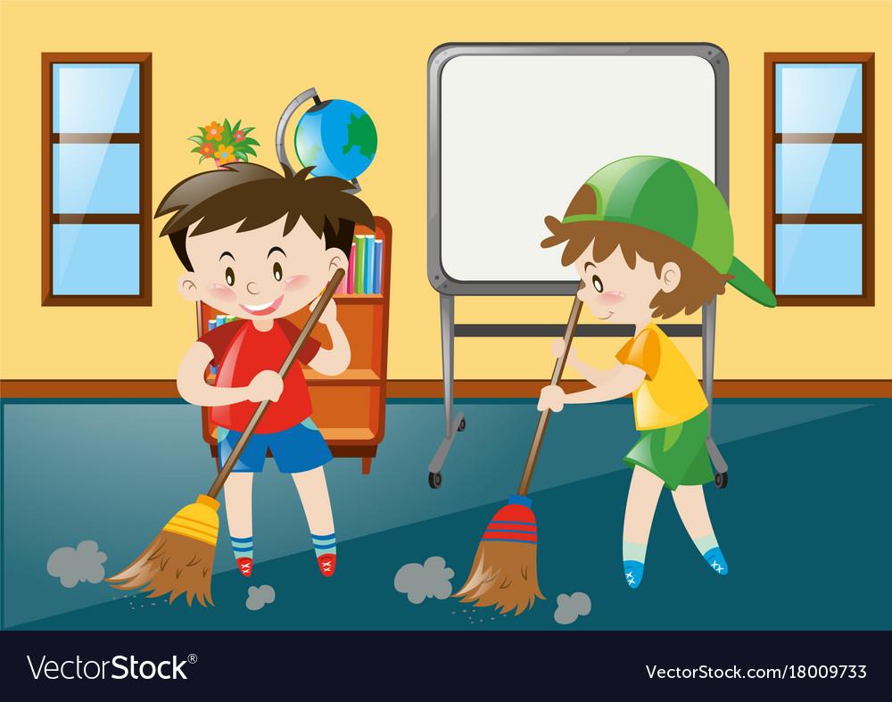 Two boys sweeping classroom floor