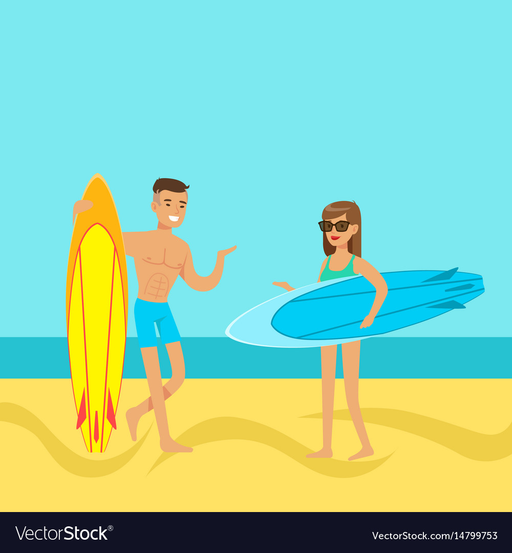 Young couple walking on the beach with surfboards