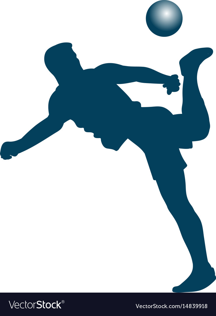 Silhouette of soccer player striking the ball