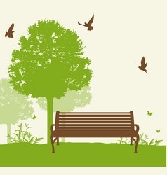 bench under a green tree vector image