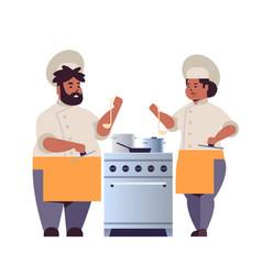 Cooks couple professional chefs preparing vector