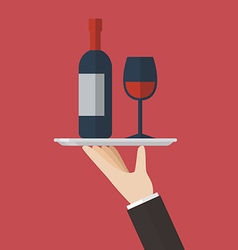 Waiter serving a wine bottle and wine glass vector image