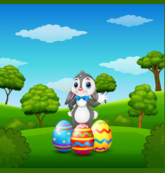 Cartoon bunny waving hand with easter eggs in the vector