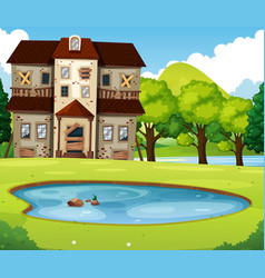Old brick house with lawn and pond vector