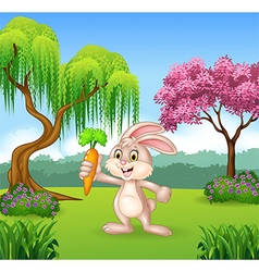 Cute bunny holding carrot in the jungle vector image vector image