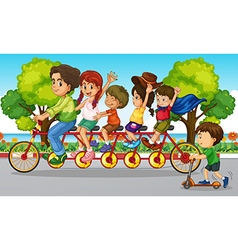 Family riding bike in the park vector image
