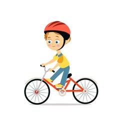happy little boy in helmet riding bicycle vector image