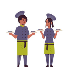 Asian chefs couple holding trays with fresh sushi vector
