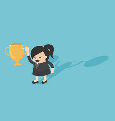 Businesswoman holds golden trophy victory vector