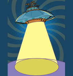 Ufo flying saucer with a shining searchlight beam vector