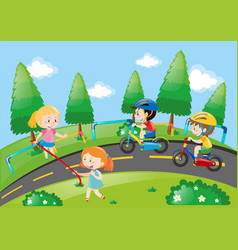 children racing bike in the park vector image