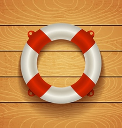 lifebuoy on light wooden bacground vector image