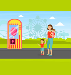 Mother with her two kids walking in amusement park vector