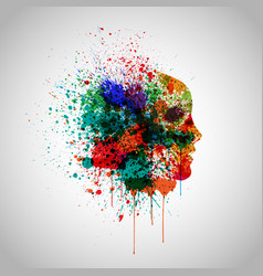 Colorful face made by spilled paint vector