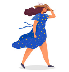 Young woman walk in windy weather and hold hat vector