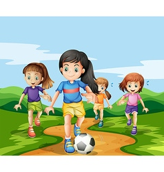 Girls playing soccker in the park vector image