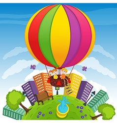 Boy and girl on hot air balloon vector