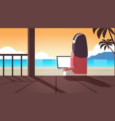 Woman using laptop on tropical sea beach summer vector