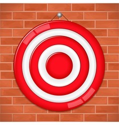 Red target on brick wall vector
