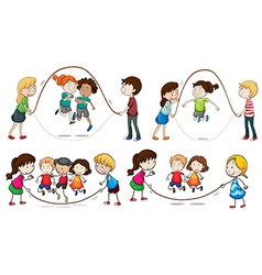 Children playing skipping rope vector image