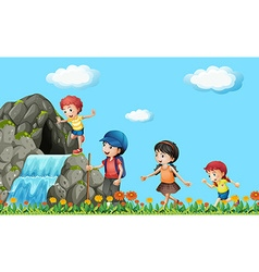 Kids hiking on the waterfall vector image