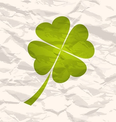 Clover with four leaves on crumpled paper vector