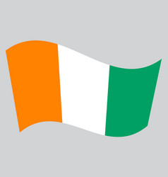 flag of ivory coast waving on gray background vector image vector image